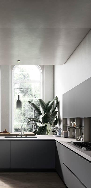 Open moderne witte en grijze keuken in L-vorm door Sébastien PRIELS | Raison Home - 2