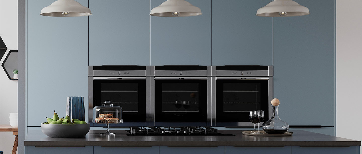 Cropped appliances in blue kitchen